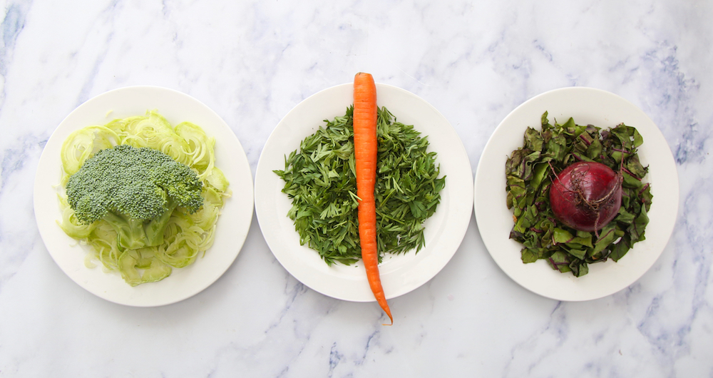 healthy eating trends of using the whole broccoli, carrot and beet on individual plates.