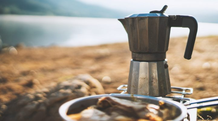 Coffee pot outdoors by a lake