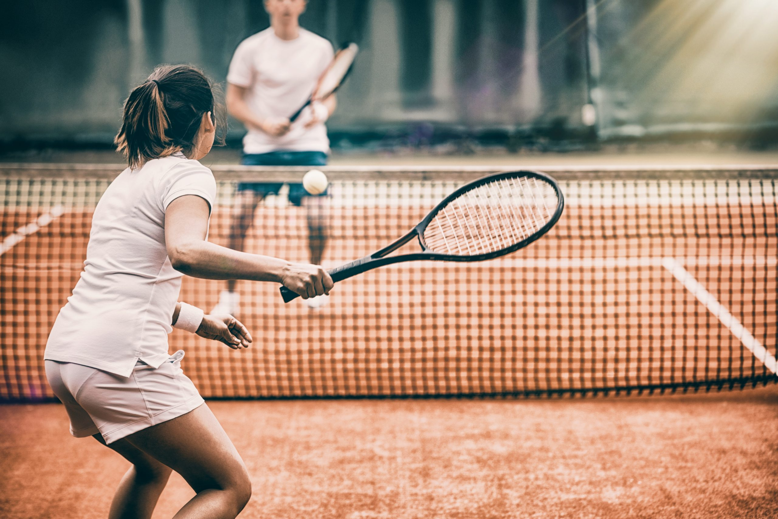 Tennis players playing a match on the court