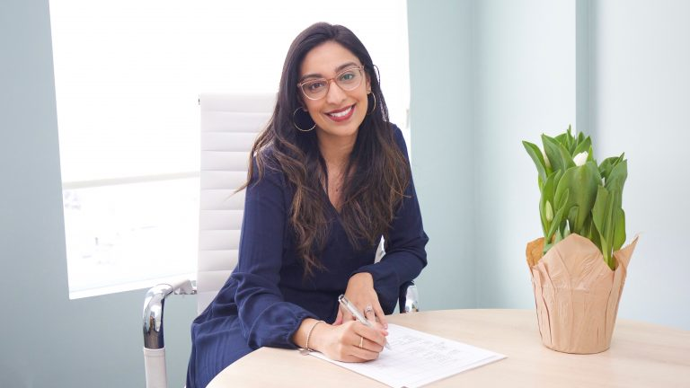 A picture of NutriProCan RD Alia Virjee at the office