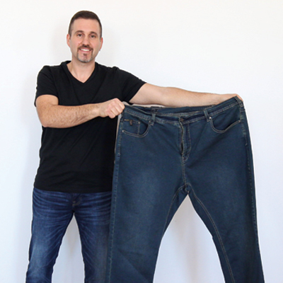 Rob holding jeans in his old size