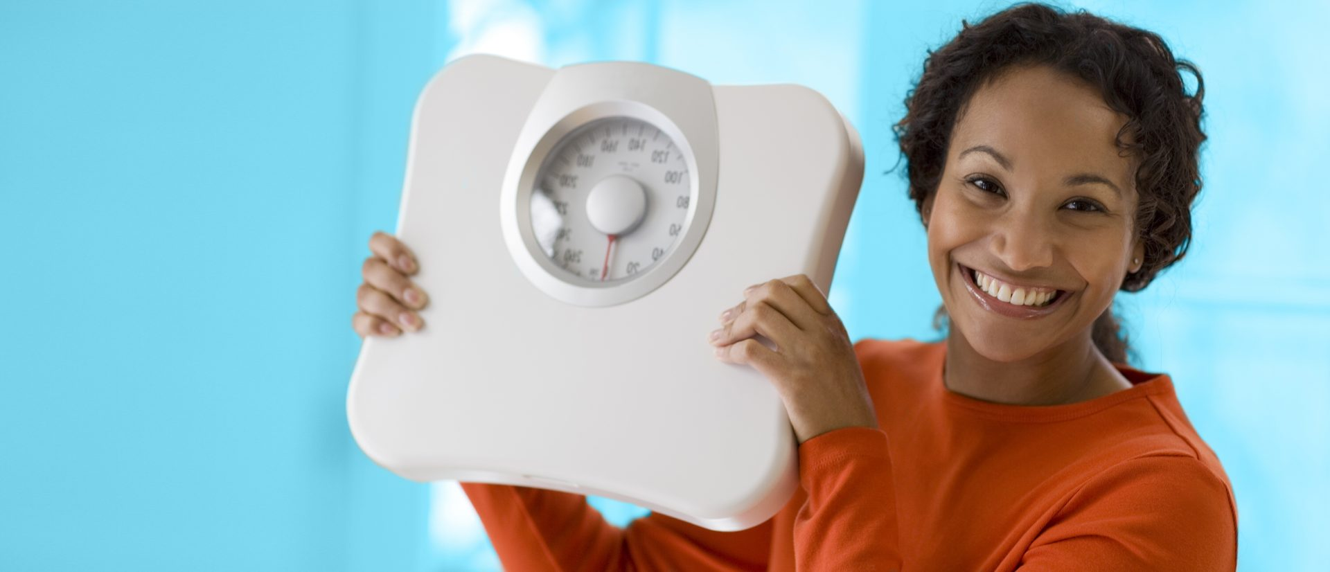 A woman holding a scale