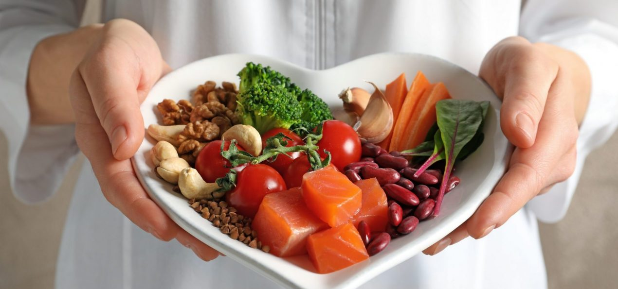 heart healthy foods on a heart shaped serving dish
