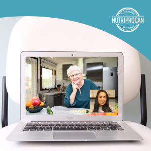 A picture of a laptop screen showing a client in their kitchen and dietitian on a video call with her