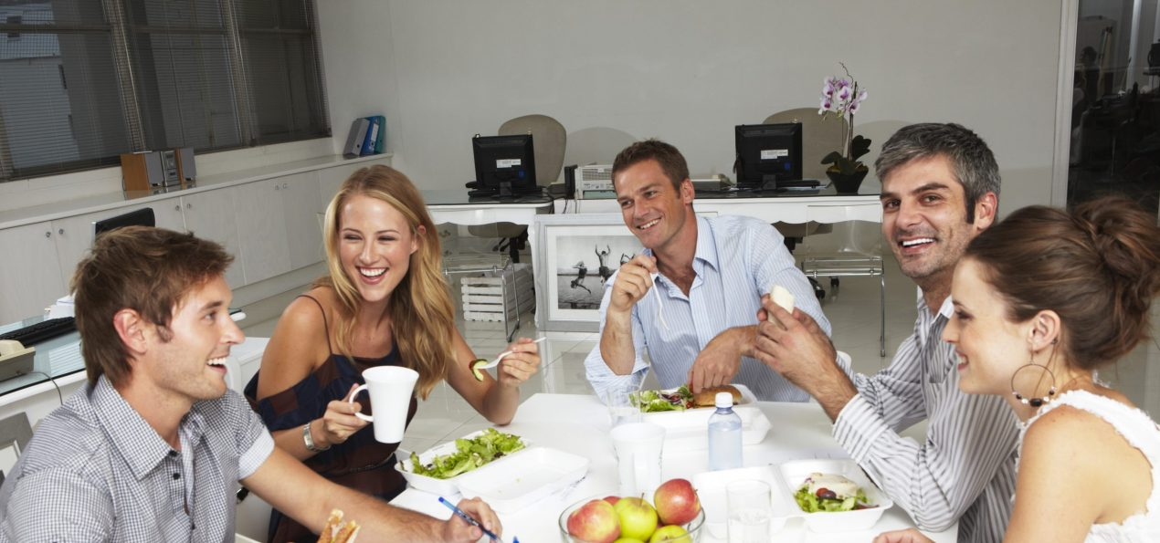 Employees eating together in a lunchroom