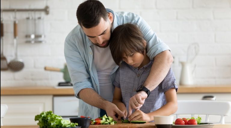 father teaching food skills to a son