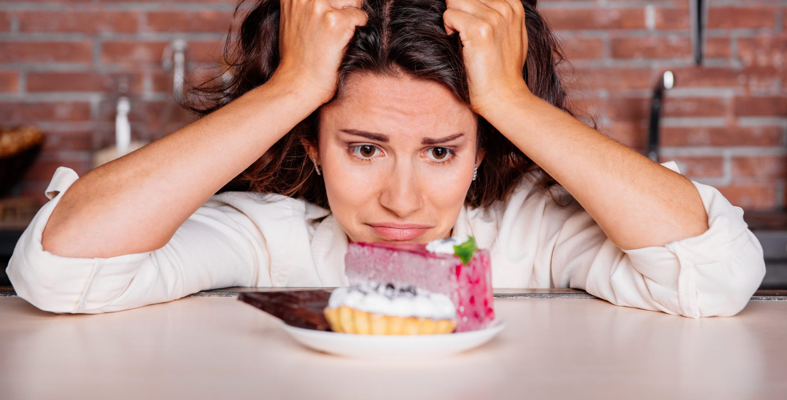 Woman craving to eat cake.