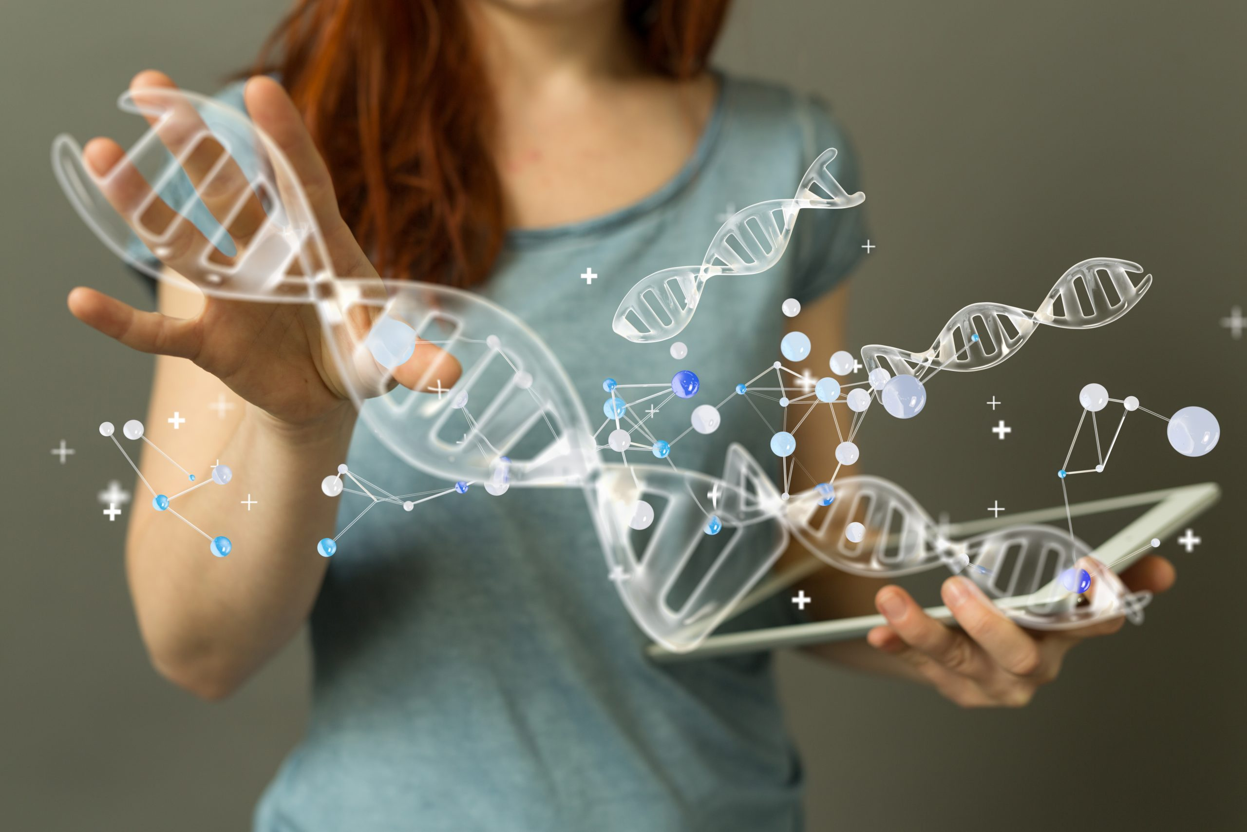 A picture of a female and a graphic of genes