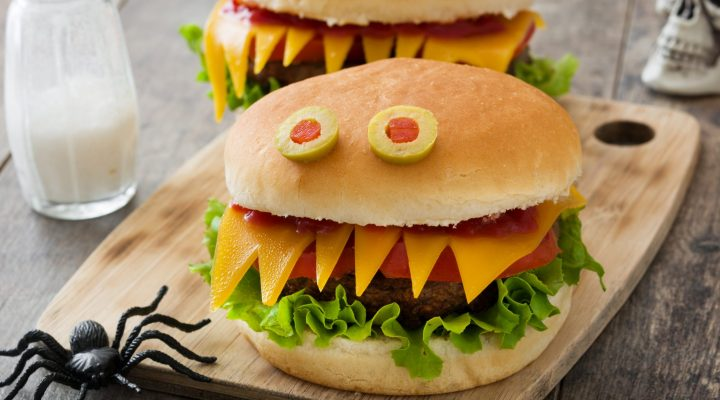 Halloween hamburgers on a cutting board