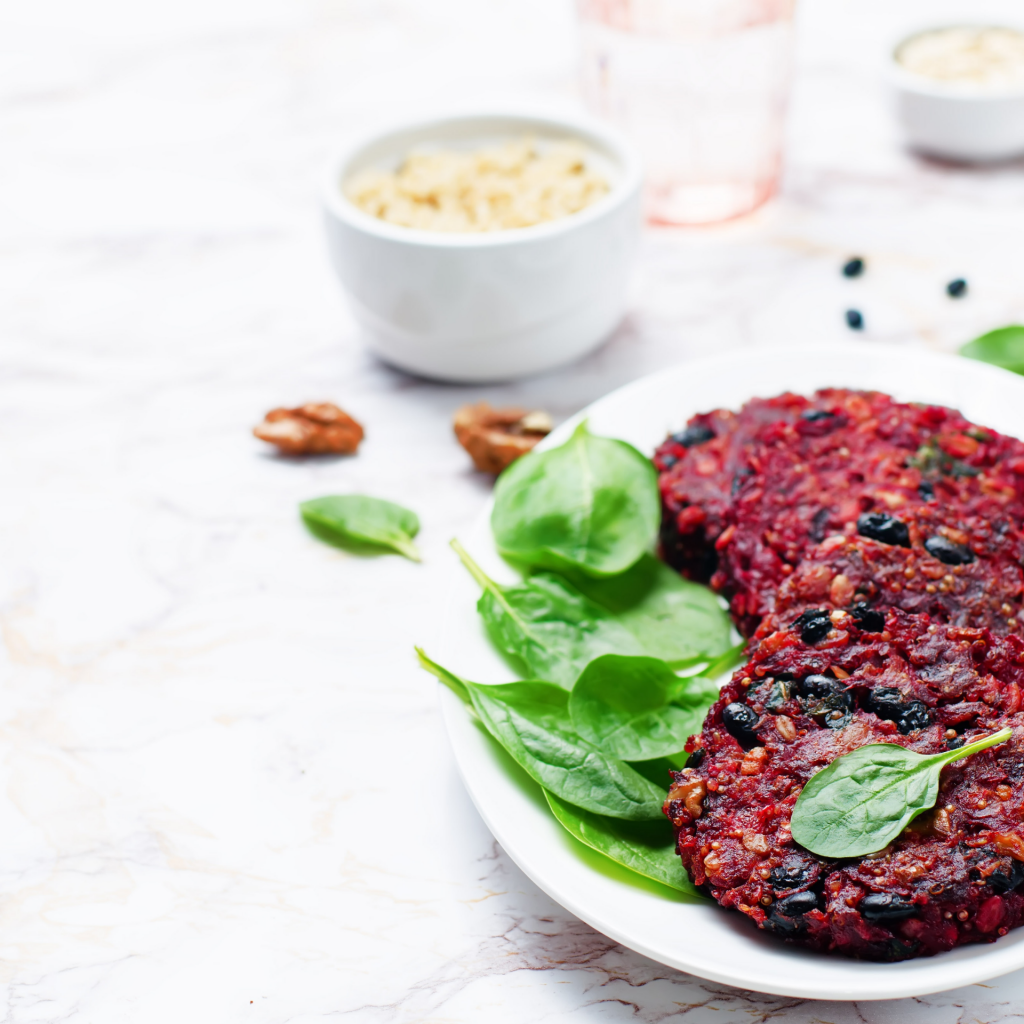 Image with beetroot and bean patties on a plate
