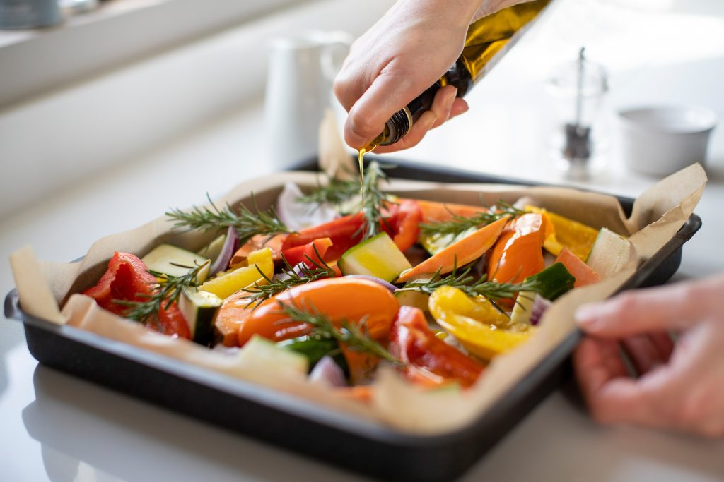 pouring cooking oils on roasted vegetables